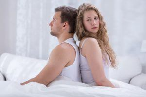 Couple with marital problems sitting back to back